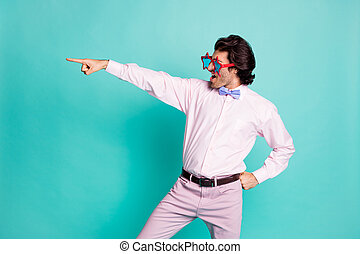 Profile photo of charming brunet curly hair dancer wear pink outfit pointing looking empty space isolated teal color background