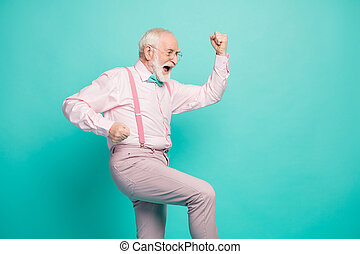 Profile photo of funny crazy excited hipster grandpa raise fists up celebrating money income wear specs pink shirt suspenders bow tie pants isolated teal color background