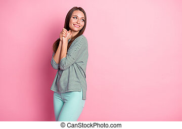 Profile photo of lovely young girl look empty space wear striped shirt teal pants isolated pastel pink color background