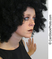 Profile - Girl with afro-wig posing.