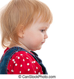 Profile portait of a thoughtful little girl