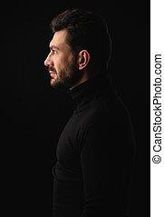 profile portrait of a bearded man
