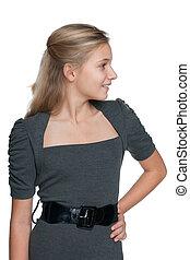Profile portrait of a blonde teen girl
