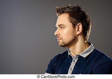 Profile portrait of a handsome young man. Men's beauty.
