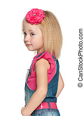Profile portrait of a pensive little girl