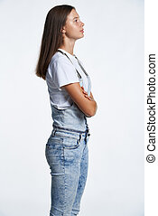 Profile portrait of a teen girl standing looking in front