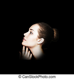 Profile portrait of beautiful woman.