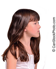 Profile portrait of little girl with long beautiful hair