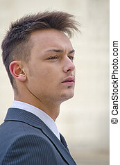 Profile portrait of young businessman in suit