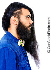 Profile portrait of a young brunet man with a beard and long haired. Hairstyle. Isolated over white.