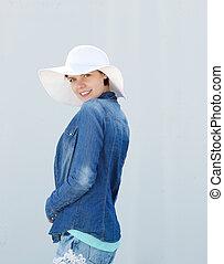 Profile portrait young woman smiling