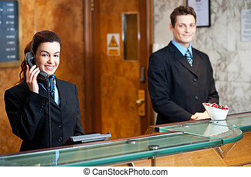 Profile shot of attractive executives at the reception
