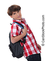 Profile shot of boy with backpack