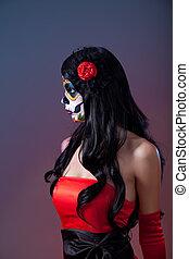 Profile shot of sugar skull girl