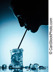 profile silhouette of woman drinking cold water with ice