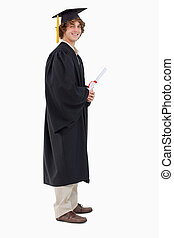 Profile view of a student in graduate robe