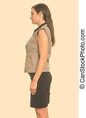Profile view of beautiful Italian businesswoman standing