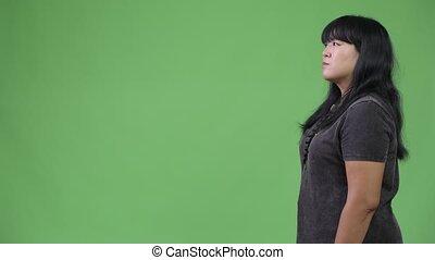 Profile view of beautiful overweight Asian woman - Studio...