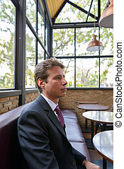 Profile view of businessman thinking at the cafe