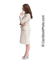 Profile view of doubtful businesswoman standing