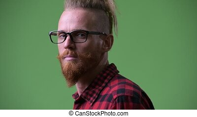 Profile view of handsome bearded hipster man with dreadlocks...