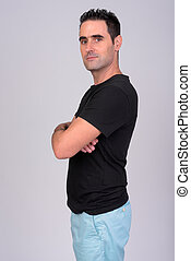 Profile view of handsome man against white background
