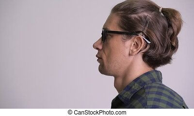 Profile view of happy hipster man with eyeglasses smiling -...