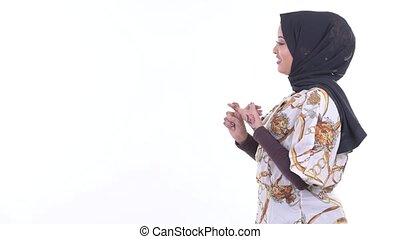 Profile view of happy young African Muslim woman being...