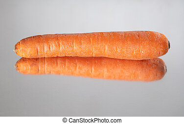 Profile view of isolated single carrot reflected