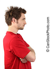 Profile view of man stood with arms crossed