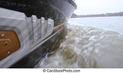 Motor boat - Profile view of the Motor boat splashing the...