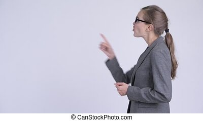 Profile view of young angry businesswoman talking and complaining