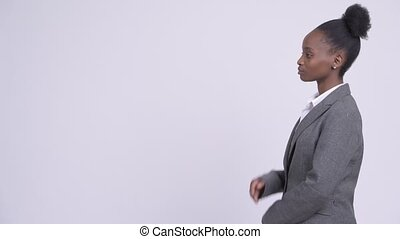 Profile view of young beautiful African businesswoman...