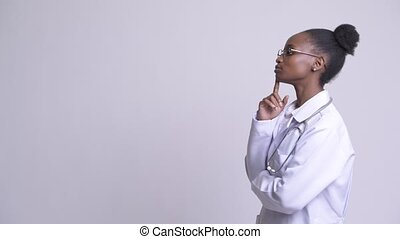 Profile view of young beautiful African woman doctor...