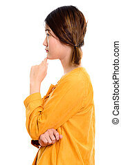 Profile view of young beautiful Asian woman thinking