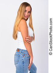 Profile view of young beautiful blonde woman looking at camera
