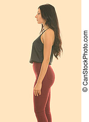 Profile view of young beautiful businesswoman standing