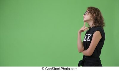 Profile view of young beautiful nerd woman thinking - Studio...
