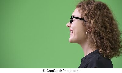 Profile view of young happy beautiful nerd woman - Studio...