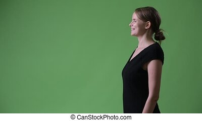 Profile view of young happy businesswoman