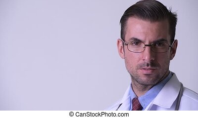 Profile view of young Hispanic man doctor