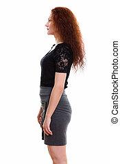 Profile view portrait of businesswoman standing in studio
