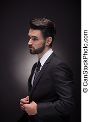 profile young man handsome elegant suit hands black