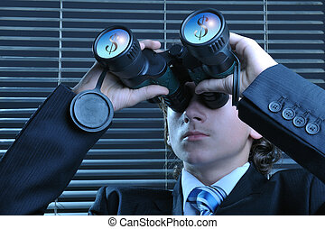 Profitable vision - Young businessman looking through...