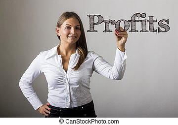 Profits - Beautiful girl writing on transparent surface