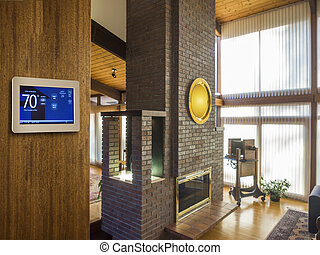 Programmable thermostat for temperature control on living...