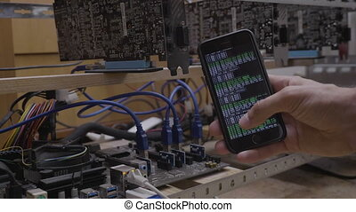 Programmer engineer using mining software application on his...