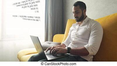 Programmer Working at Home - Handsome bearded programmer man...