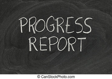 progress report headline handwritten with white chalk on blackboard with eraser smudges