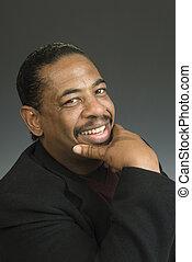 Portrait head shot of a smiling Black American male